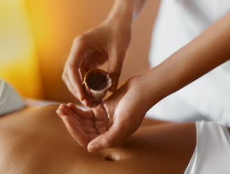 Spa massage. Aromatherapy oil massage. Masseur doing aromatherapy oil massage on beautiful young healthy caucasian woman body in  spa salon. Beauty treatment concept. Skincare, wellbeing, wellness, lifestyle.